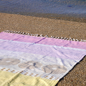 Common Texture extra large summer essential beach towel in pure cotton; off white sorbet stripes with unique hand block print. Use at pool, beach, sofa cover up or yoga blanket.