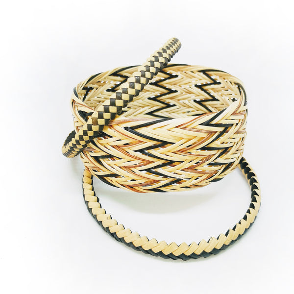 Common Texture handmade woven and plaited rattan bangle bracelet set in natural colored shades and patterns.