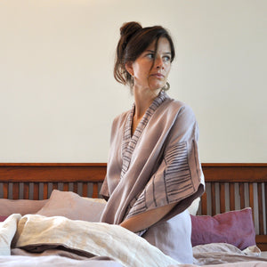Common Texture pure linen women's robe Bamboo with hand block printed details along the collar and kimono style sleeves styled with small spiral wood earrings.