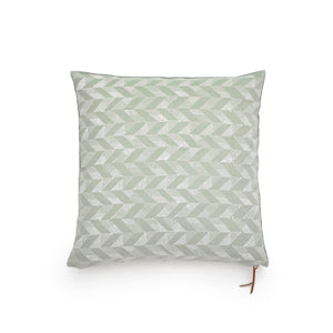 Common Texture square pure linen cushion cover featuring a hand block printed trapeze pattern in cream on pastel green with contrasting gold zip and leather pull tag.