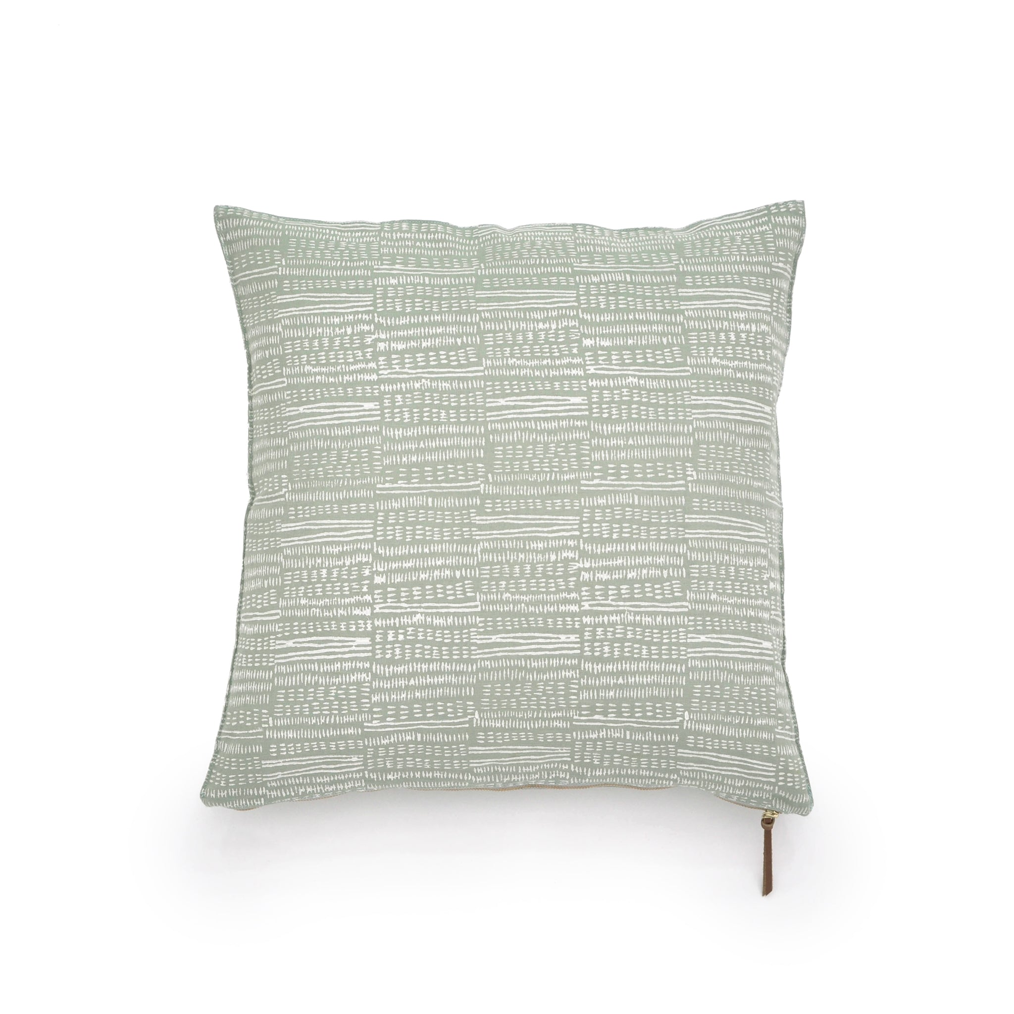 Common Texture square pure linen cushion cover featuring a hand block printed dash pattern in cream on pastel green with contrasting gold zip and leather pull tag.