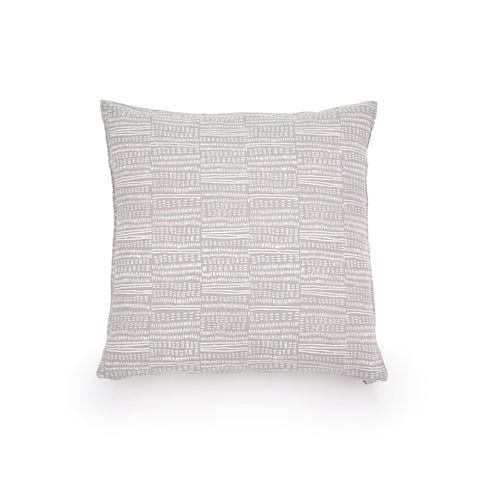 Common Texture square pure linen cushion cover featuring a hand block printed dash pattern in cream on pastel pale grey with contrasting gold zip and leather pull tag.