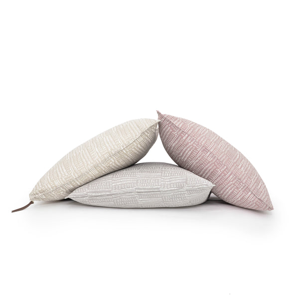 Set of Common Texture square pure linen cushion covers featuring a hand block printed dash pattern in cream on pastel pink, beige and pale grey with contrasting gold zip and leather pull tag.