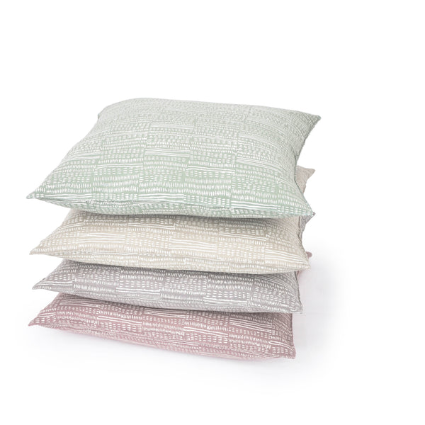 Common Texture square pure linen cushion covers featuring a hand block printed dash pattern in cream on pastel with contrasting gold zip and leather pull tag.