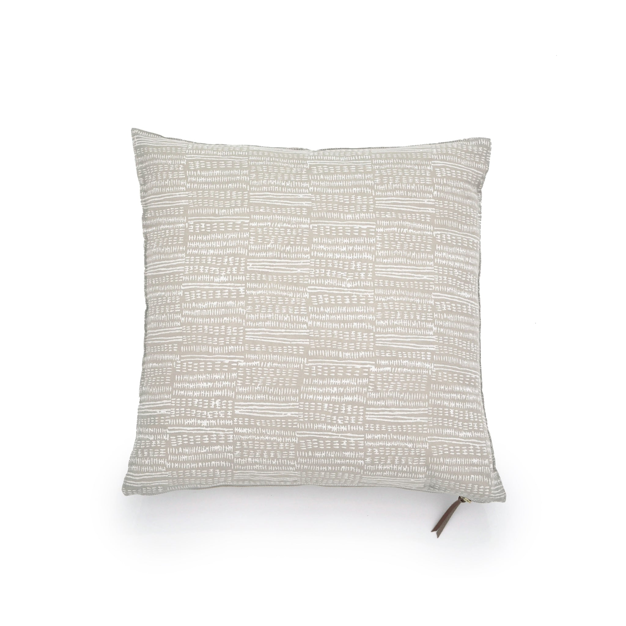 Common Texture square pure linen cushion cover featuring a hand block printed dash pattern in cream on pastel beige with contrasting gold zip and leather pull tag.