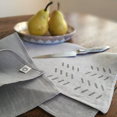 Common Texture hand block printed linen placemat set with matching napkins in sand ecru and cool grey stone.