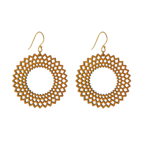 Common Texture laser cut wood drop earrings with a big spiral geometric design.