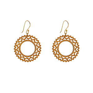 Common Texture laser cut wood drop earrings with a small spiral geometric design.