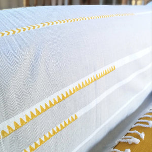 Common Texture extra large summer essential beach towel in pure cotton; white grey stripes with unique hand block print in turmeric yellow. Use at pool, beach, sofa cover up or yoga blanket.