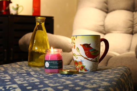 Cosy Jasmine Scented Candle with a tea cup creating warm ambiance