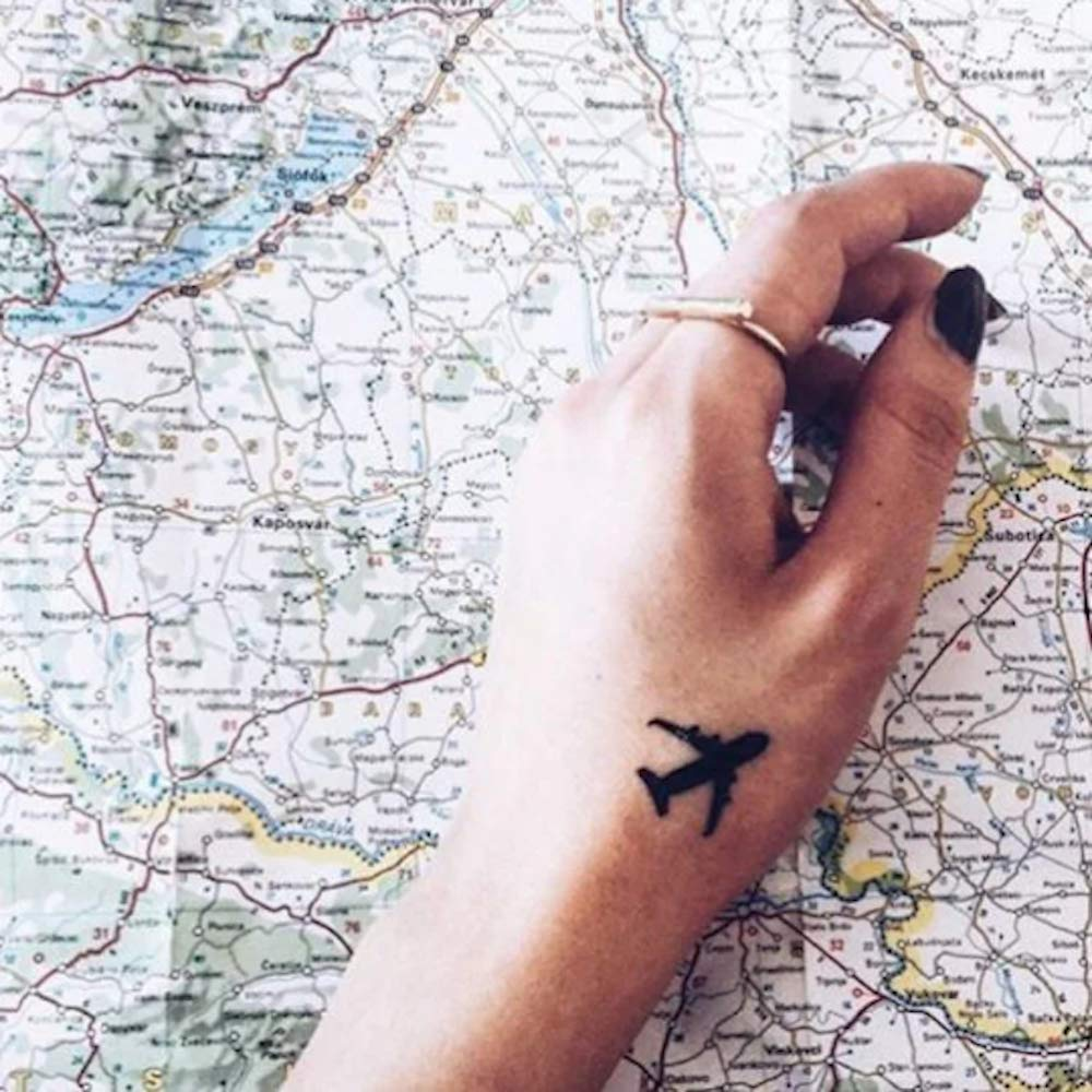 small airplane travel minimalist temporary tattoo sticker design idea on wrist