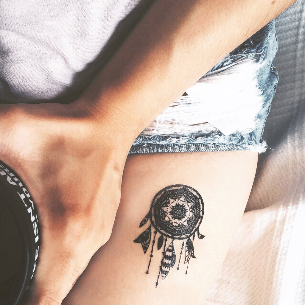 small dream catcher bohemian temporary tattoo sticker design idea on thigh