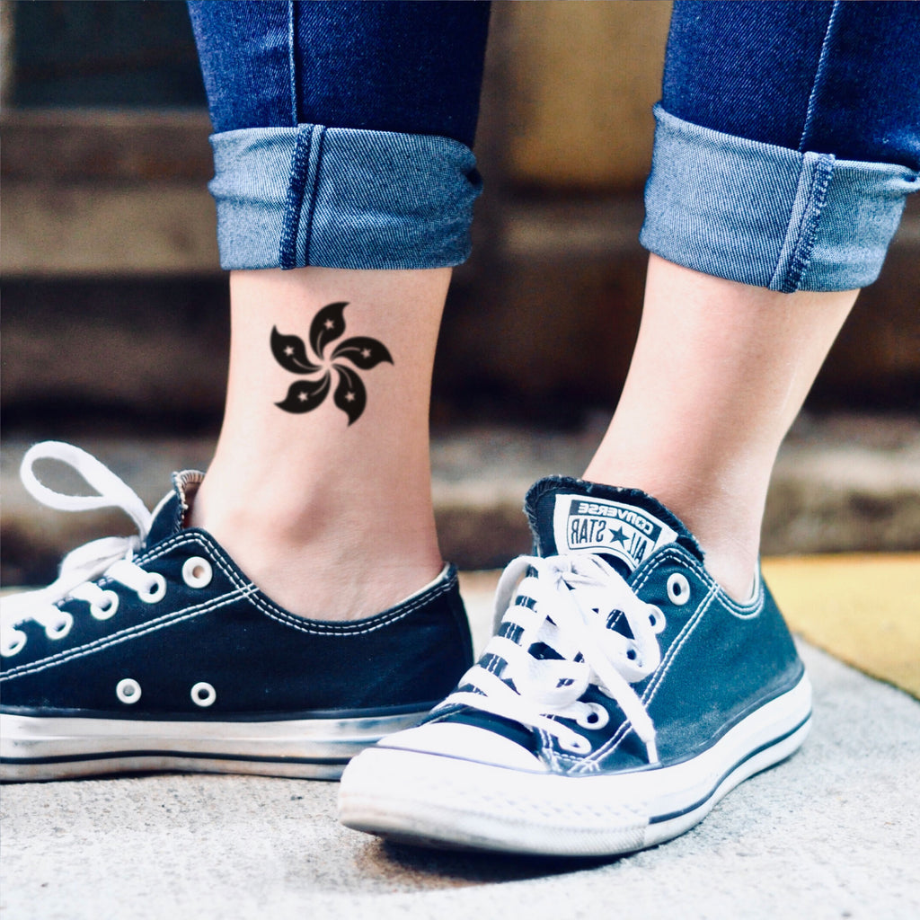 fake small hong kong regional emblem flag (香港特別行政區區徽區旗 Hong Kong Special Administrative Region) black color flower temporary tattoo sticker design idea on ankle leg