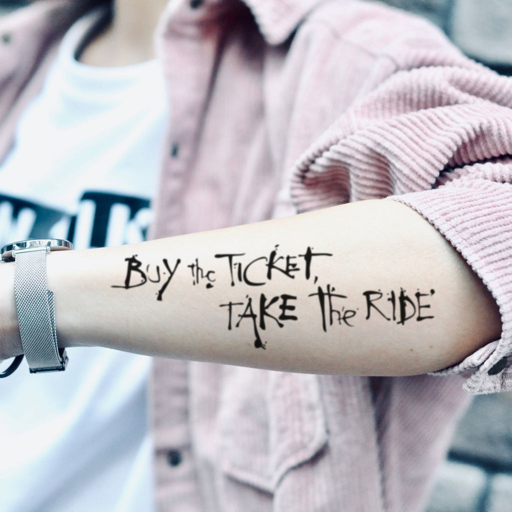 fake big buy the ticket take the ride lettering temporary tattoo sticker design idea on forearm