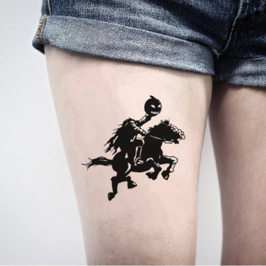fake big headless horseman pumpkin halloween illustrative temporary tattoo sticker design idea on thigh