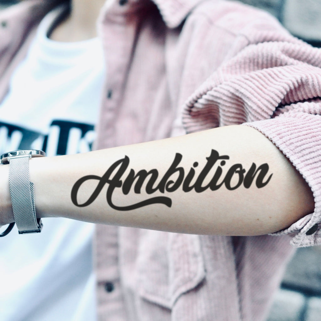 fake medium ambition cursive script lettering temporary tattoo sticker design idea on forearm