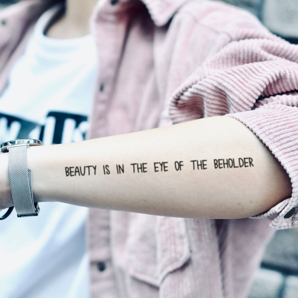 fake medium beauty is in the eye of the beholder lettering temporary tattoo sticker design idea on forearm