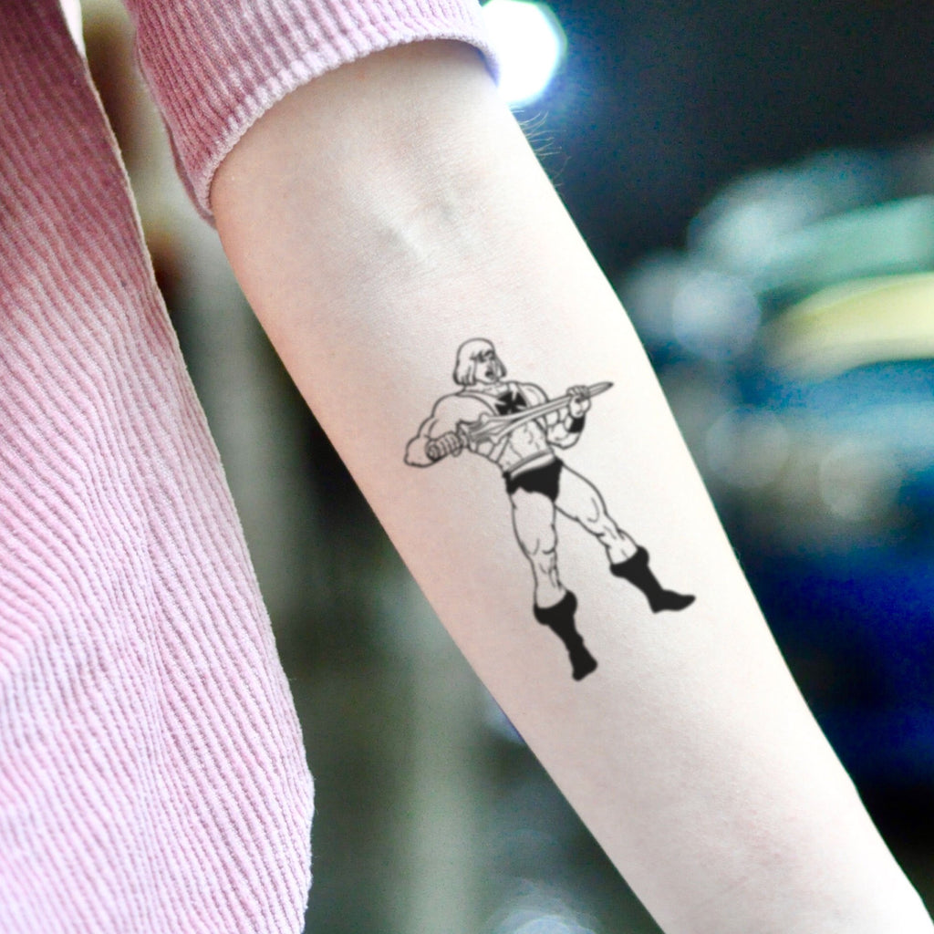 fake medium he-man cartoon temporary tattoo sticker design idea on inner arm