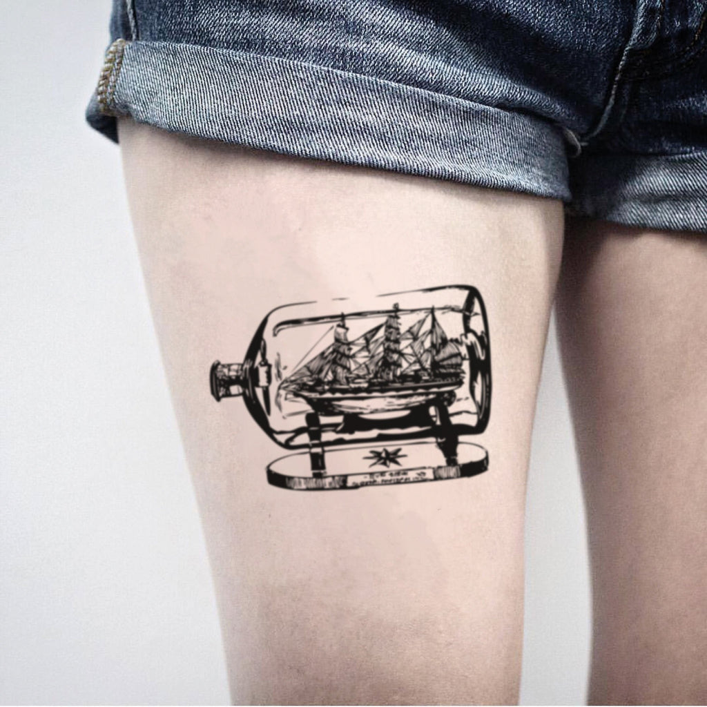 fake medium ship in a bottle vintage temporary tattoo sticker design idea on thigh