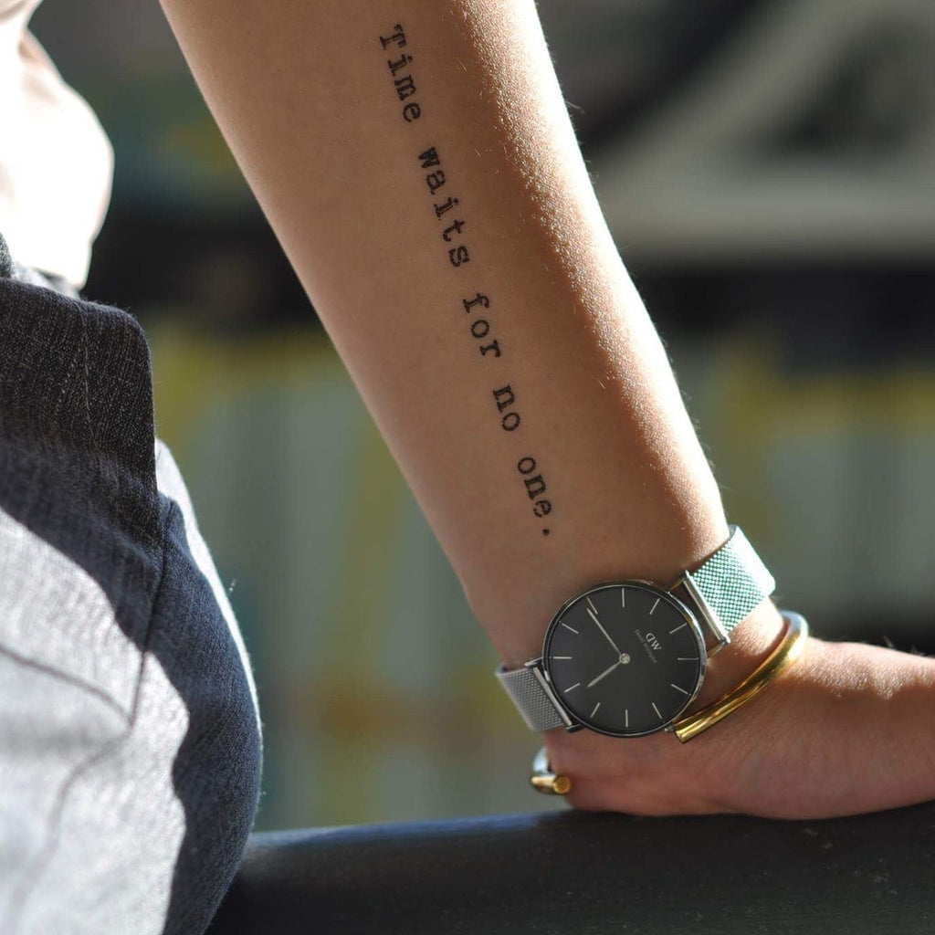 fake medium time waits for no one lettering temporary tattoo sticker design idea on forearm