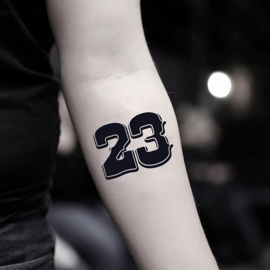 fake small michael jordan 23 lettering temporary tattoo sticker design idea on inner arm