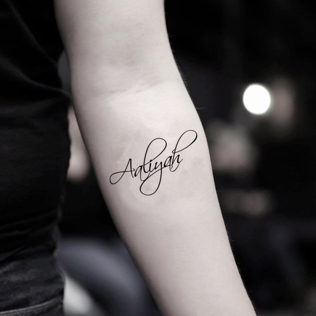 fake small aaliyah lettering temporary tattoo sticker design idea on inner arm