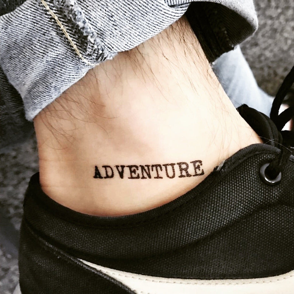 fake small adventure lettering temporary tattoo sticker design idea on ankle