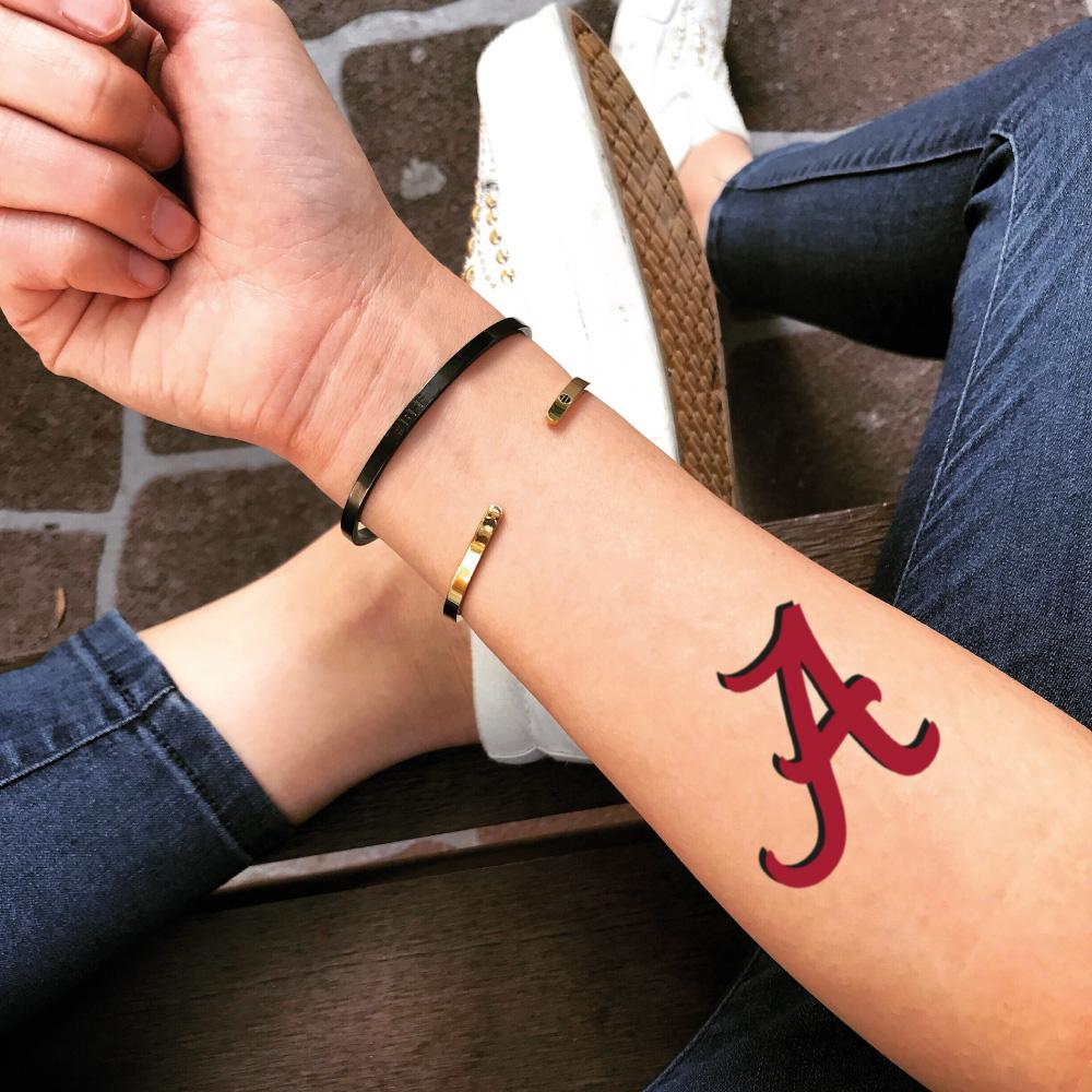 fake small alabama roll tide red lettering color temporary tattoo sticker design idea on forearm