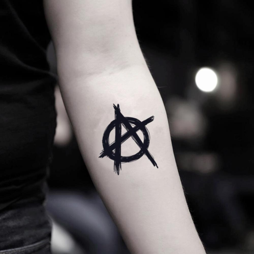 fake small anarchy illustrative temporary tattoo sticker design idea on inner arm