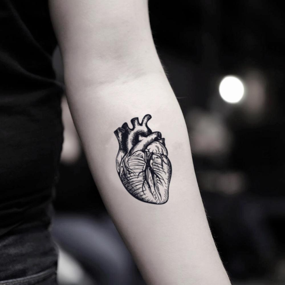 fake small anatomical heart biology illustrative temporary tattoo sticker design idea on inner arm