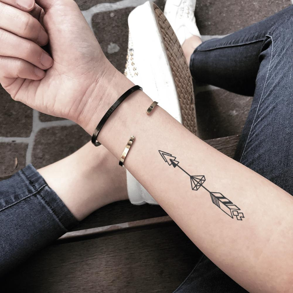 fake small arrow through diamond geometric temporary tattoo sticker design idea on forearm
