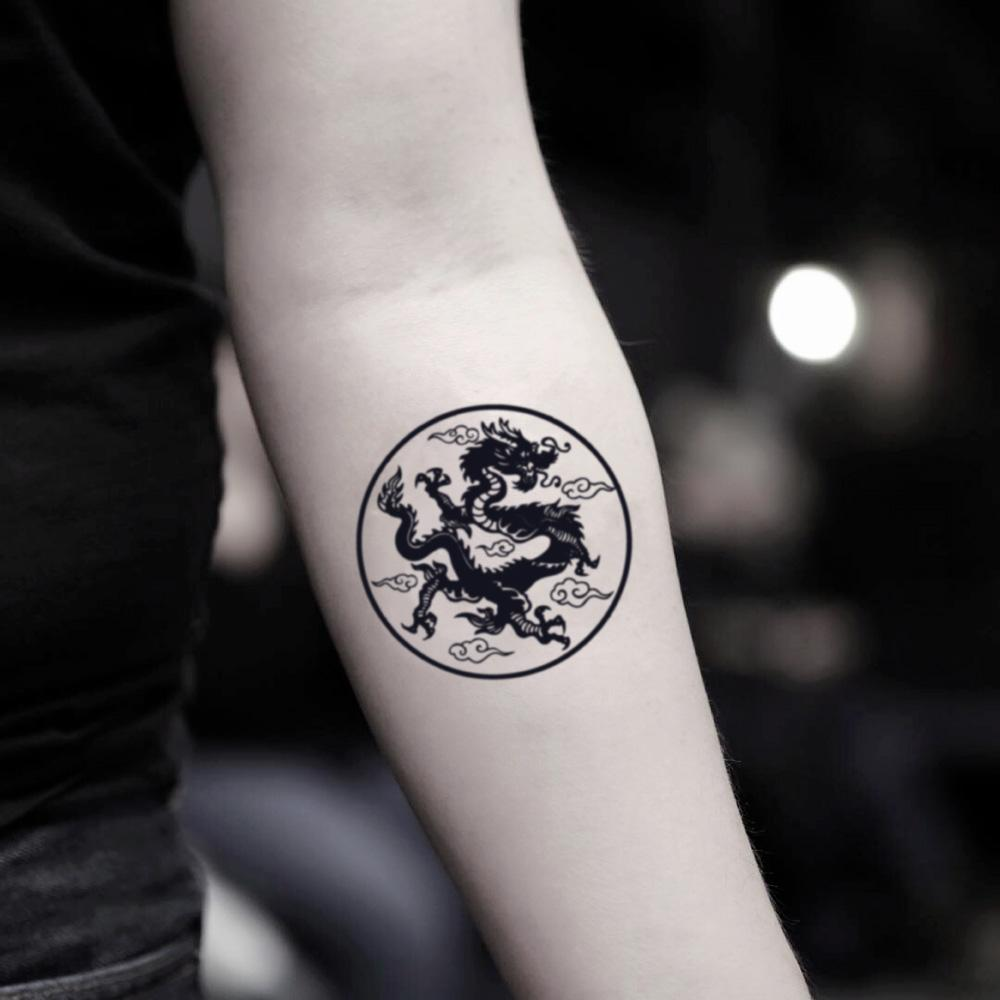 fake small asian earth dragon circle illustrative temporary tattoo sticker design idea on inner arm