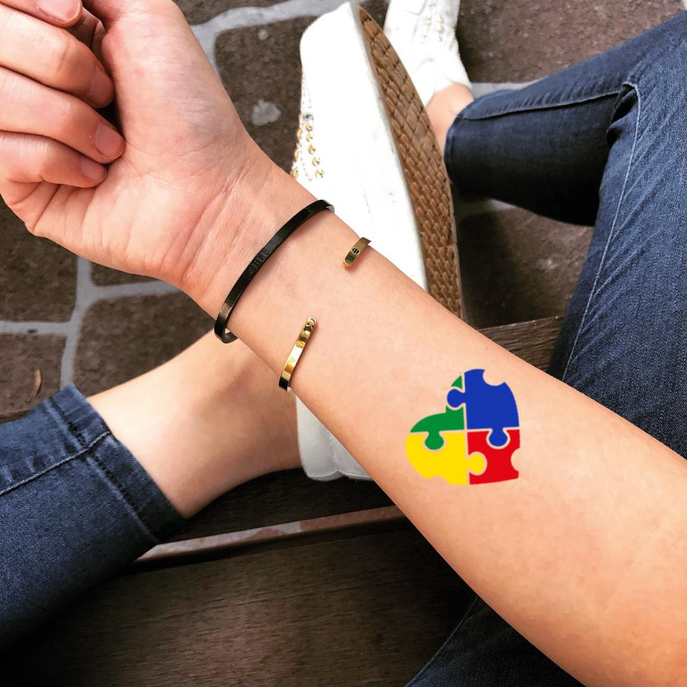 fake small autism special needs color temporary tattoo sticker design idea on forearm
