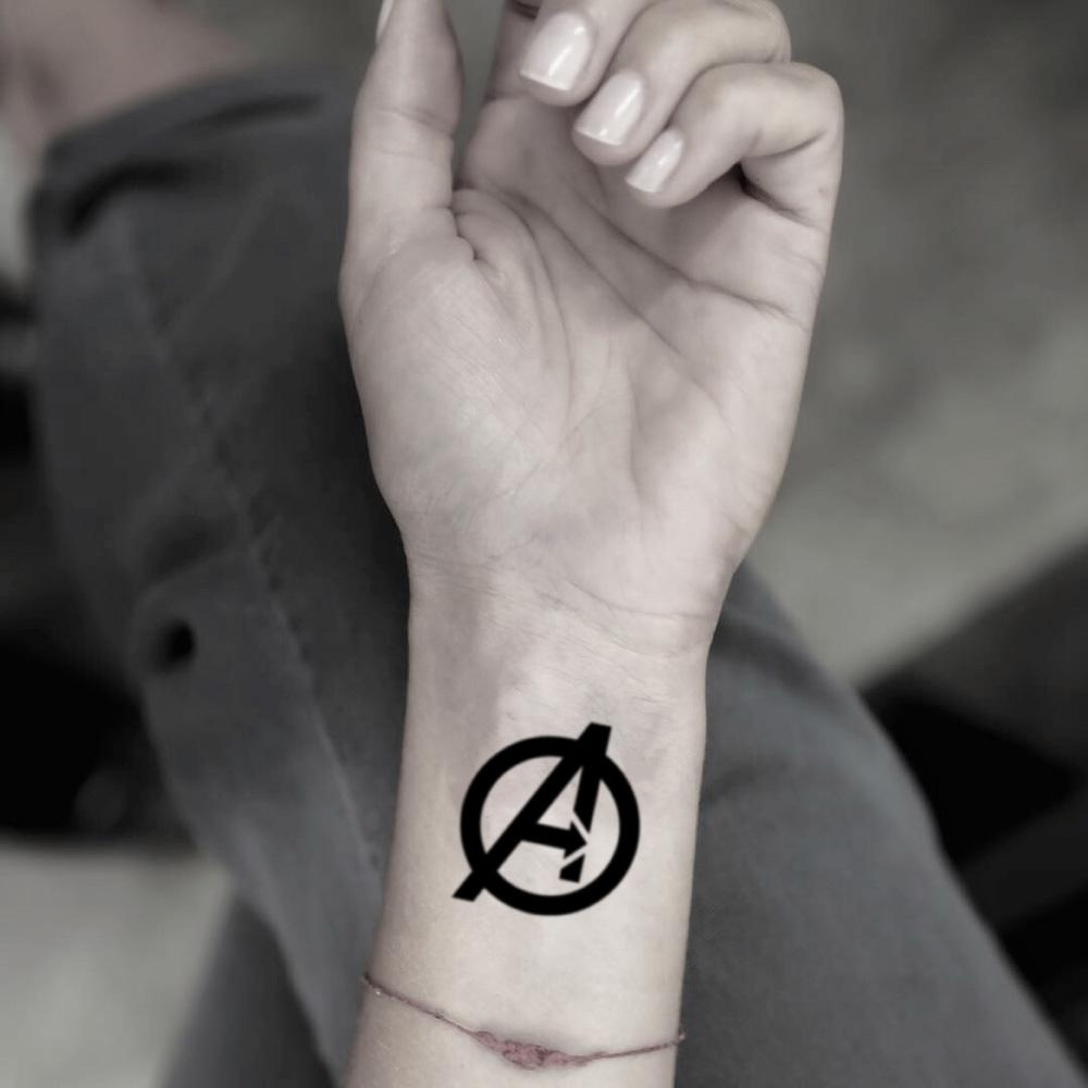 fake small avengers logo illustrative temporary tattoo sticker design idea on wrist