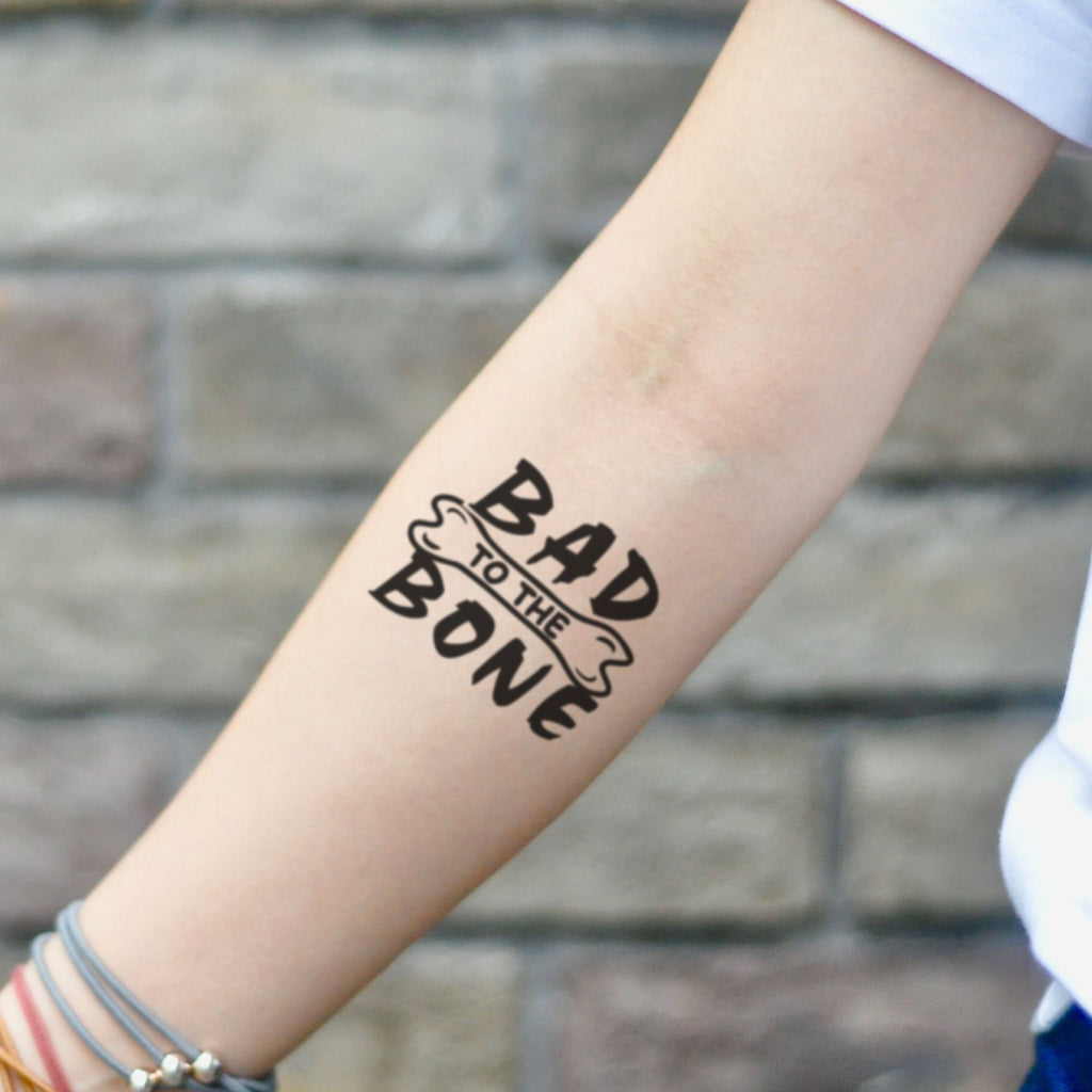 fake small bad to the bone illustrative temporary tattoo sticker design idea on inner arm
