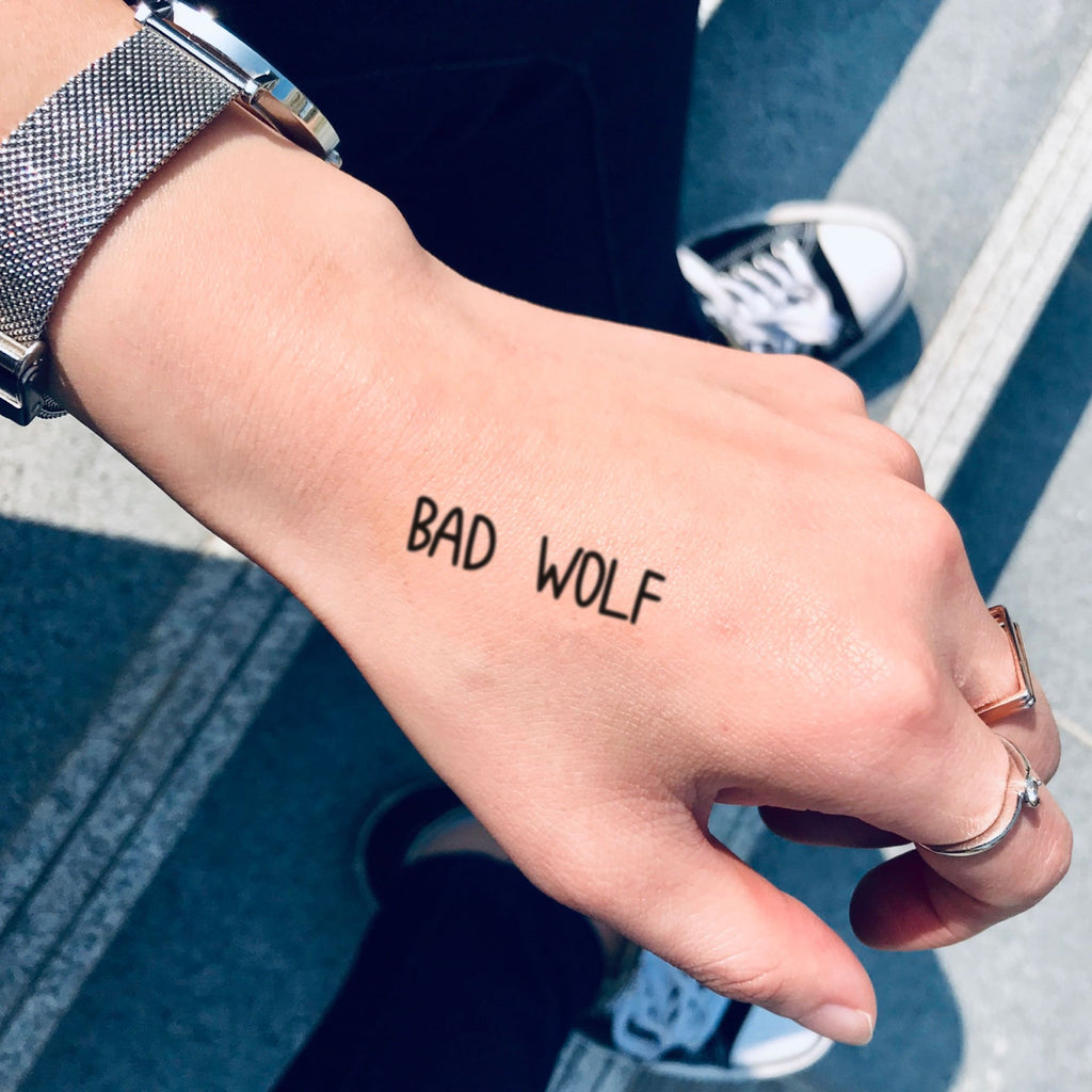 fake small bad wolf lettering temporary tattoo sticker design idea on hand