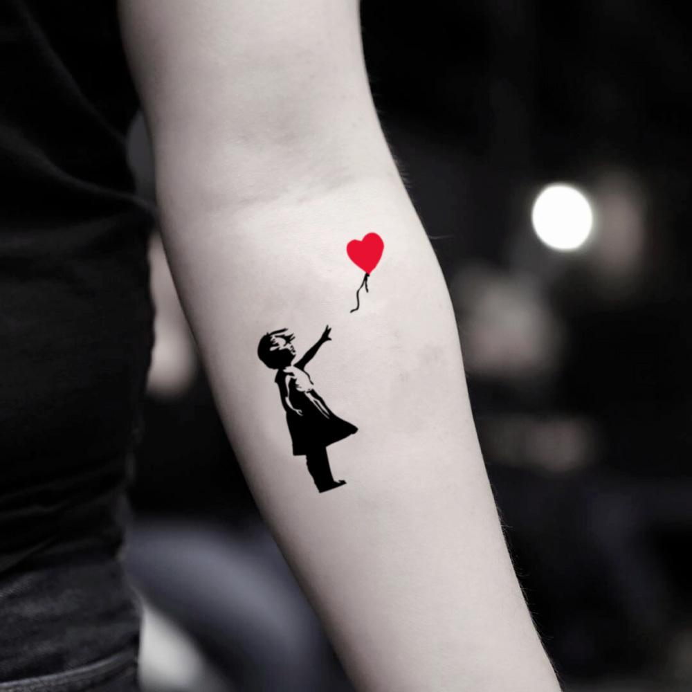 fake small banksy red heart balloon girl illustrative color temporary tattoo sticker design idea on inner arm
