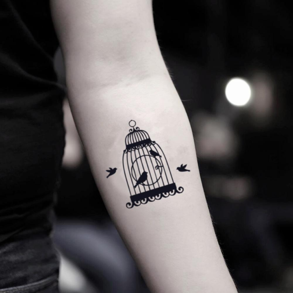 fake small bird cage illustrative temporary tattoo sticker design idea on inner arm