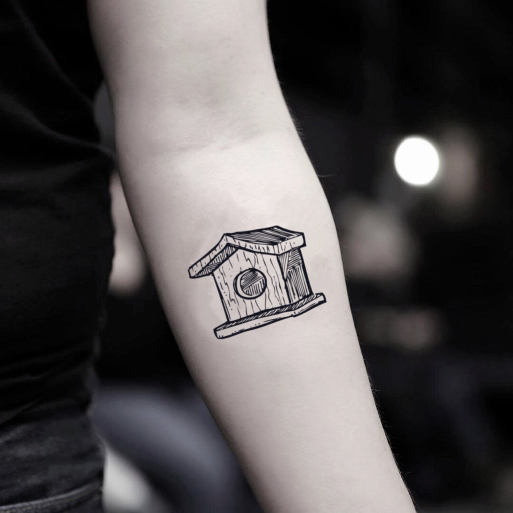 fake small birdhouse illustrative temporary tattoo sticker design idea on inner arm