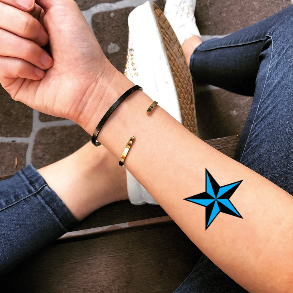 fake small black blue ink nautical 5 five point star color geometric temporary tattoo sticker design idea on forearm for men