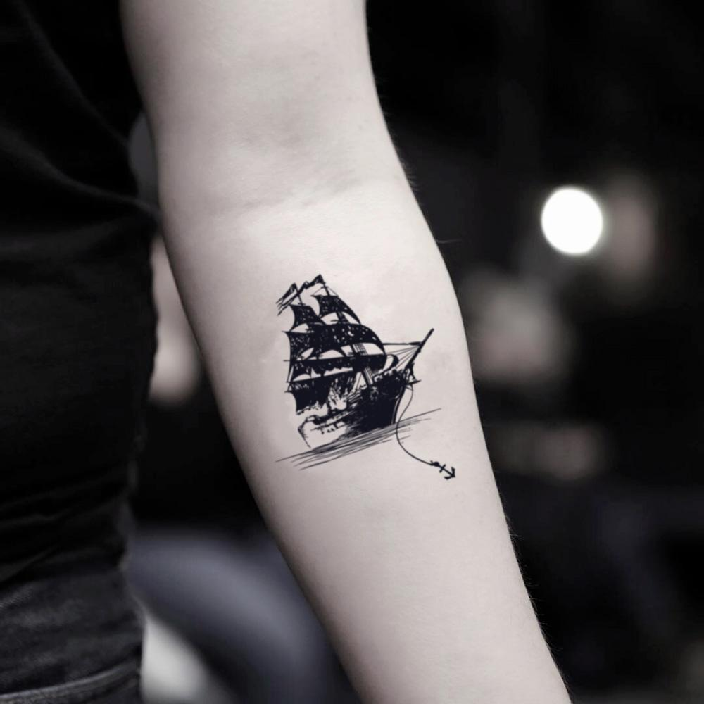 fake small black pearl clipper ghost sailing ship shipwreck homeward bound illustrative temporary tattoo sticker design idea on inner arm