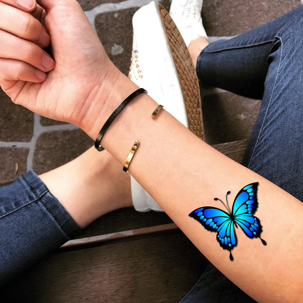 fake small light blue morpho mariposa butterfly color photo realism style animal temporary tattoo sticker design idea on forearm