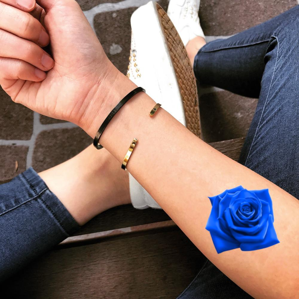 fake small blue rose flower color temporary tattoo sticker design idea on forearm