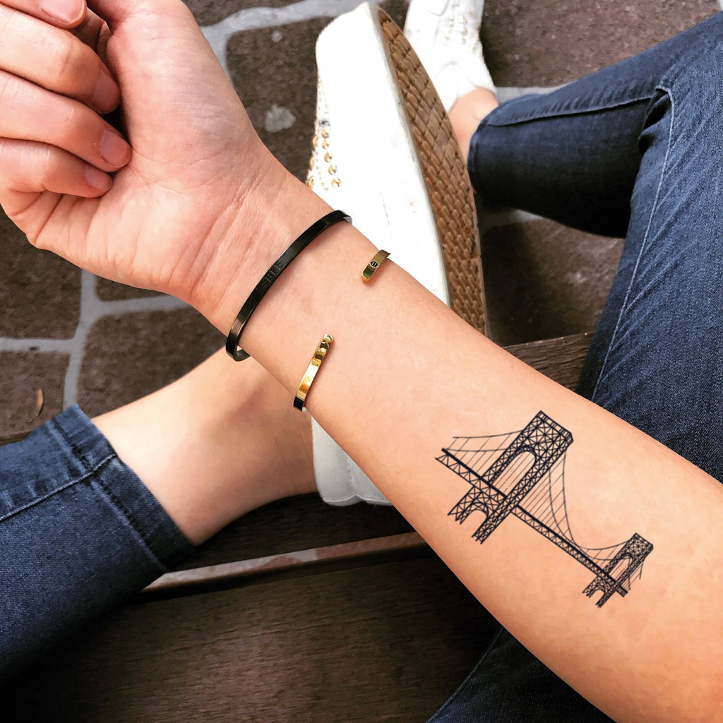 fake small golden gate bay bridge illustrative temporary tattoo sticker design idea on forearm
