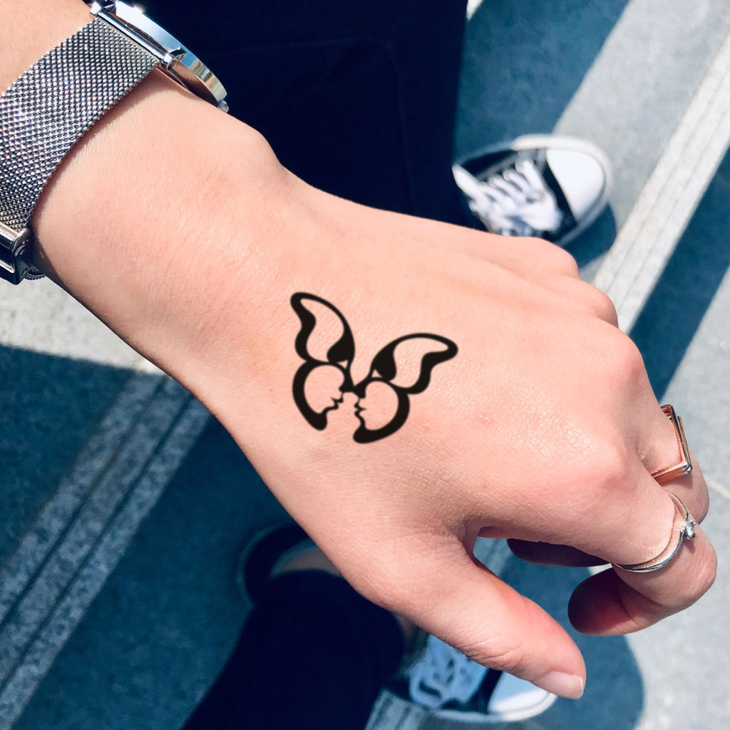 fake small butterfly kisses minimalist temporary tattoo sticker design idea on hand