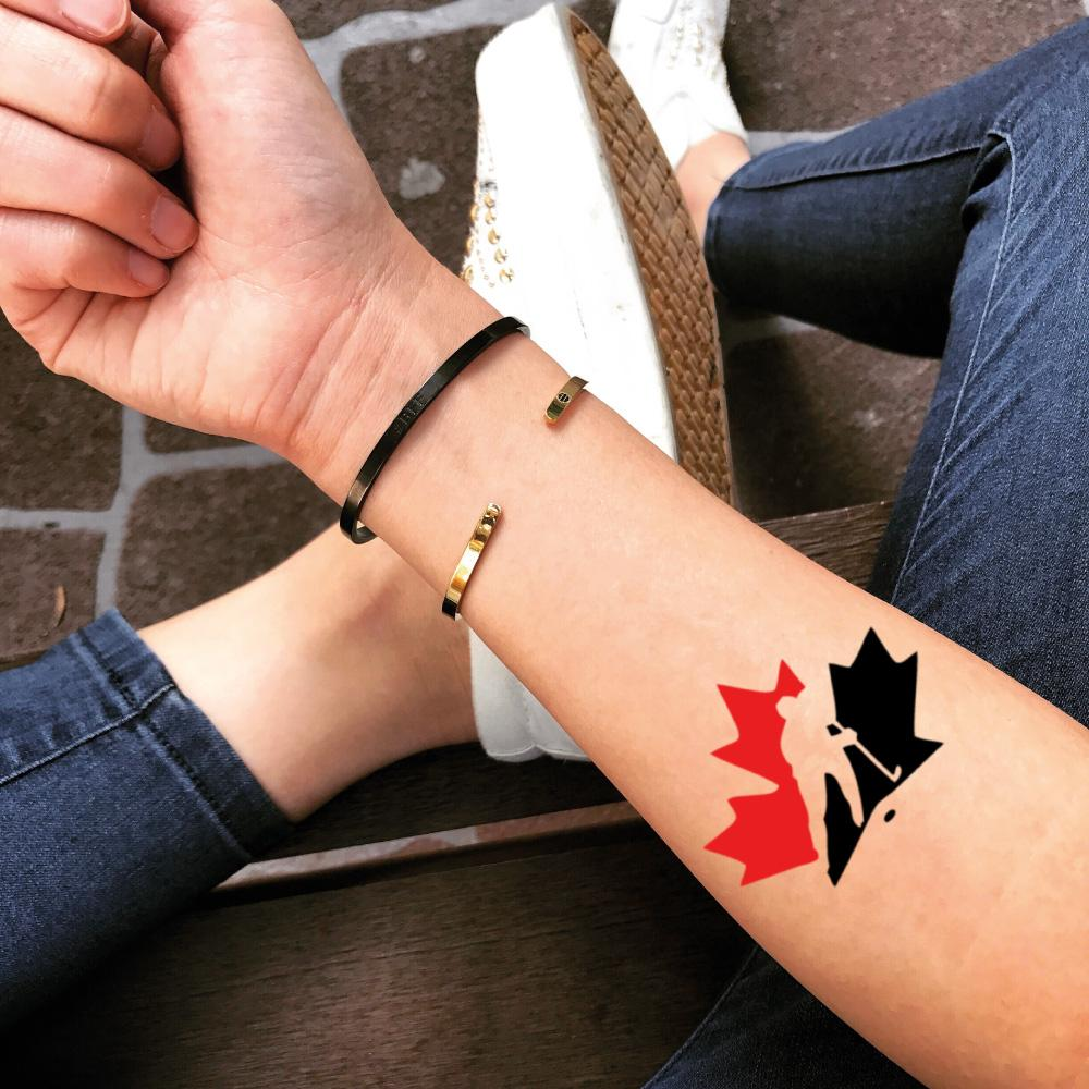 fake small canada hockey red leaf color temporary tattoo sticker design idea on forearm