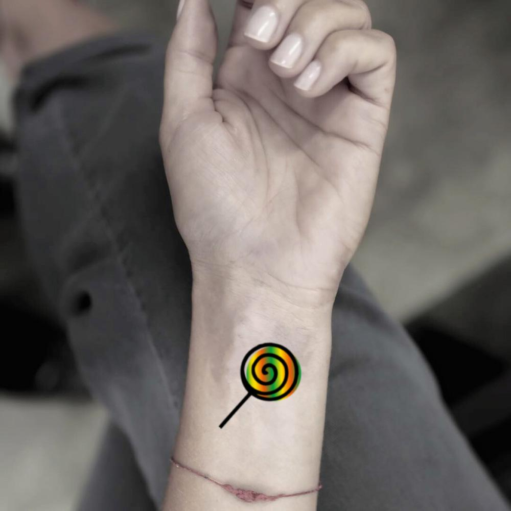 fake small candy food color temporary tattoo sticker design idea on wrist