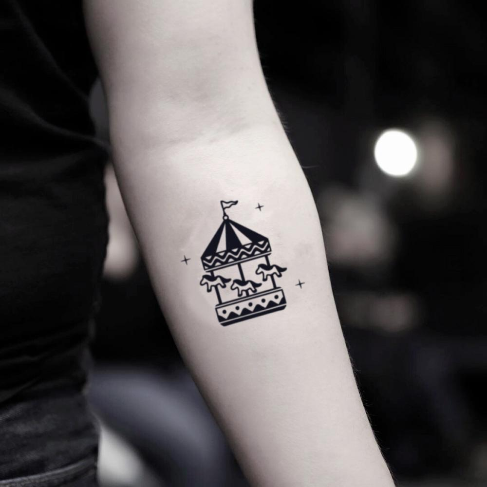 fake small carousel childhood illustrative temporary tattoo sticker design idea on inner arm