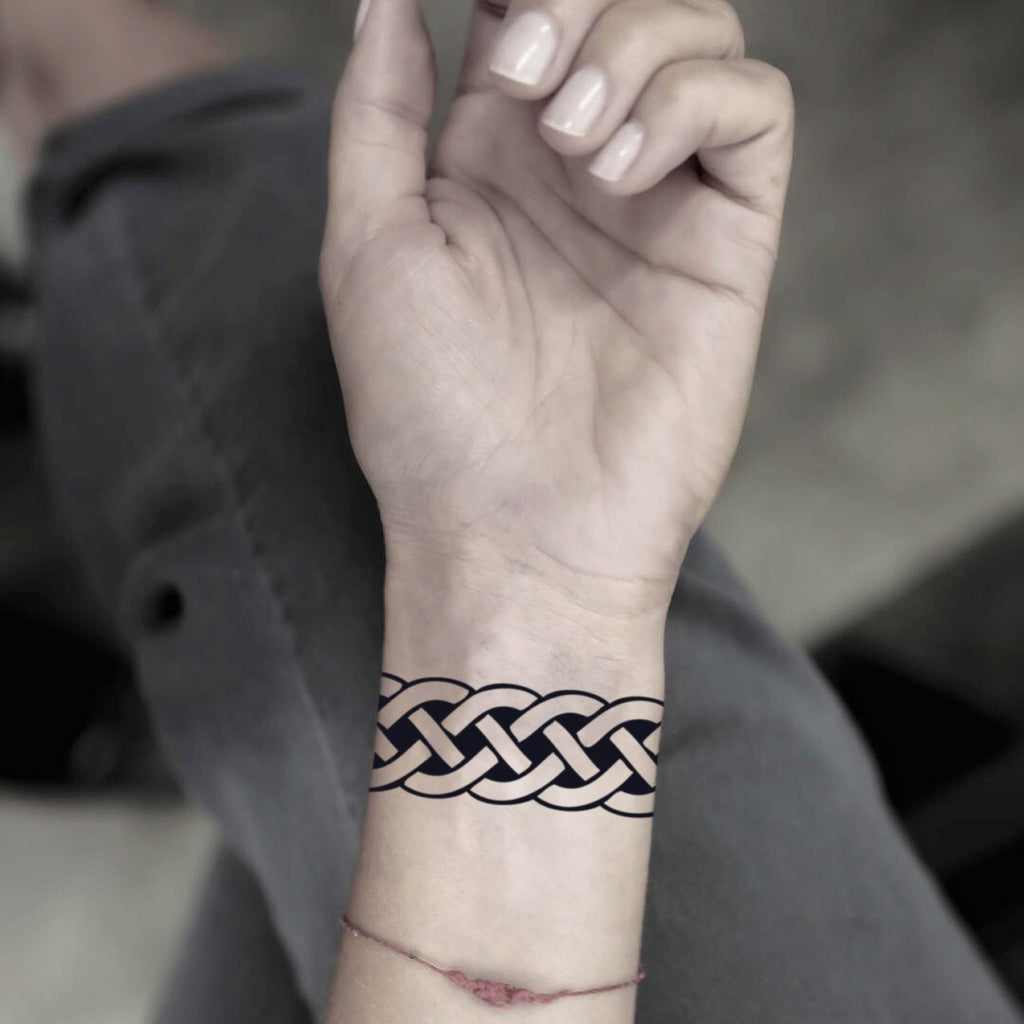 fake small celtic band shackle geometric temporary tattoo sticker design idea on wrist