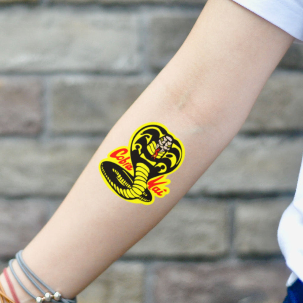 fake small cobra kai Color temporary tattoo sticker design idea on inner arm